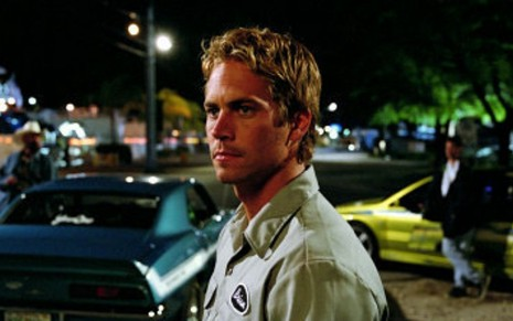 Paul Walker em cena do filme + Velozes + Furiosos