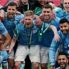 Manchester City players wear the uniform with a blue shirt and white shorts and celebrate the title of the English Championship of the 2020/2021 season